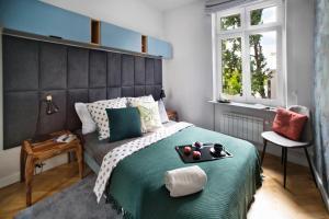 Łóżko lub łóżka w pokoju w obiekcie Blue City P&O Serviced Apartments Bialobrzeska