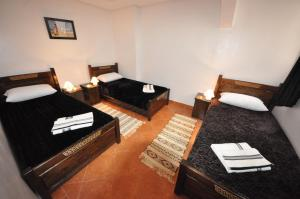 A bed or beds in a room at Hola Surf Morocco
