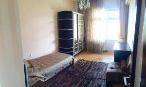 Cama ou camas em um quarto em Private Family Apartment Downtown