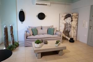 A seating area at Magnolia - Apartment in Kalamata