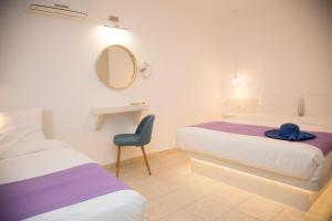 Ένα ή περισσότερα κρεβάτια σε δωμάτιο στο Markakis Studios Fira Town