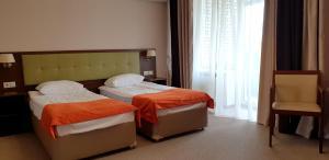 Кровать или кровати в номере Дом ветеранов кино