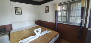 Ein Bett oder Betten in einem Zimmer der Unterkunft Green Canyon Resort
