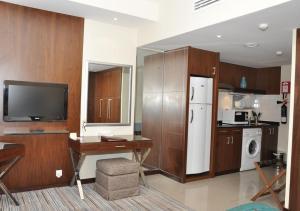 تلفاز و/أو أجهزة ترفيهية في فونيكس بلازا للشقق الفندقية