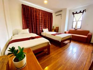 A bed or beds in a room at Ostello Bello Mandalay