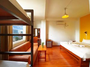 A bunk bed or bunk beds in a room at Ostello Bello Mandalay