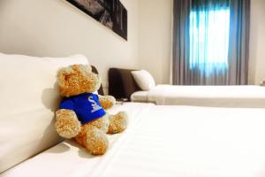 Cama ou camas em um quarto em S33 Compact Sukhumvit Hotel