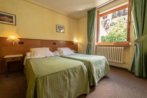 Letto o letti in una camera di Hotel Beau Sejour Pré-Saint-Didier