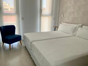 A bed or beds in a room at Apartamentos Rivero 8