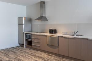 A kitchen or kitchenette at Narrabeen Sands Hotel by Nightcap Plus