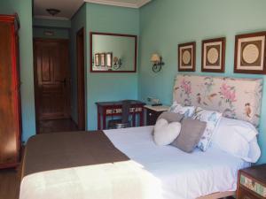 Cama o camas de una habitación en Hotel Rural la Concordia