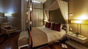 Cama ou camas em um quarto em M'AR De AR Aqueduto