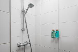 Een badkamer bij Strandhotel Duinheuvel