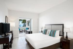 A bed or beds in a room at Peppers Beach Club & Spa
