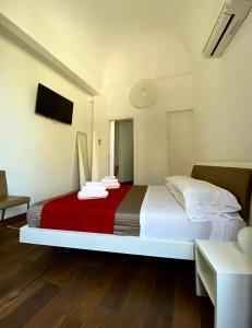 Letto o letti in una camera di Iamartino Quality Rooms