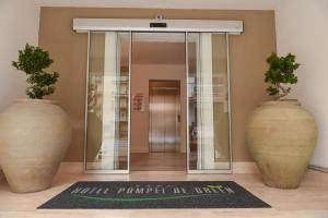 The facade or entrance of Hotel Pompei Be Green