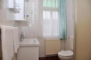Ein Badezimmer in der Unterkunft Hotel An der Kapelle