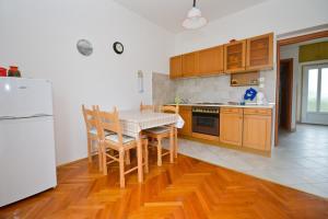 Kuchyňa alebo kuchynka v ubytovaní Nikodem Apartment