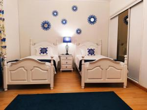 A bed or beds in a room at Santo Cristo House
