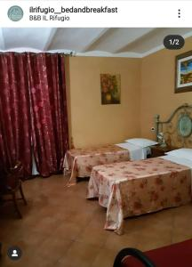 A bed or beds in a room at B&B Il Rifugio
