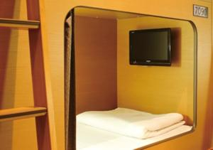A television and/or entertainment center at Capsule Hotel Nikoh Refre(Male Only)