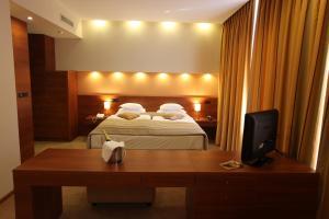 Кровать или кровати в номере Hotel Central