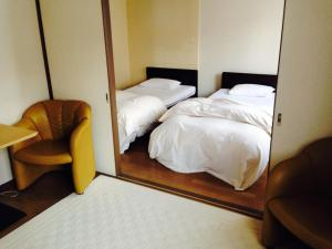 A bed or beds in a room at Seoul Garden