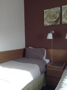 A bed or beds in a room at The Premier Lodge