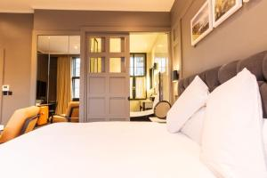 A bed or beds in a room at The Dean Dublin