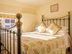 A bed or beds in a room at The Fauconberg