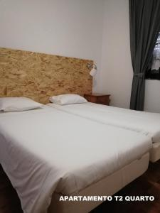 A bed or beds in a room at Hotel Eira Da Pedra