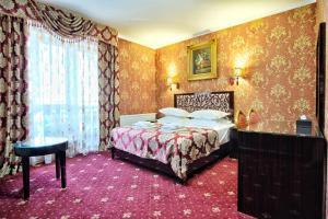 Кровать или кровати в номере Отель Rosa Del Viento