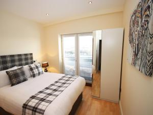 A bed or beds in a room at High Quays