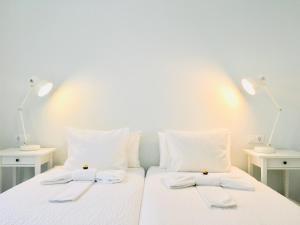 Cama o camas de una habitación en El Hotelito 27