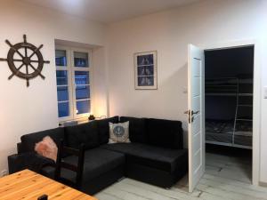 """A seating area at Apartament """"Pod dwiema Sowami"""""""