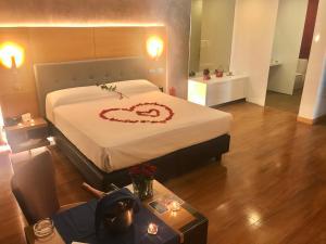 Uma cama ou camas num quarto em Motel Portofino