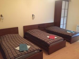 Кровать или кровати в номере Гостевой Домик Зеленый Бор