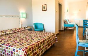 A bed or beds in a room at Hotel O'scià