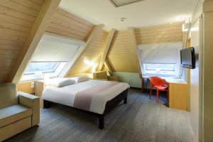 Кровать или кровати в номере ibis Chur