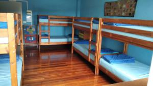 A bunk bed or bunk beds in a room at Meiga Backpackers Hostel