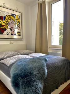 A bed or beds in a room at Chez Coco Apartment 2 Aachen