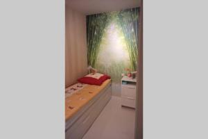 A bed or beds in a room at AS-Immobilien, Unterkunft in Bielefeld