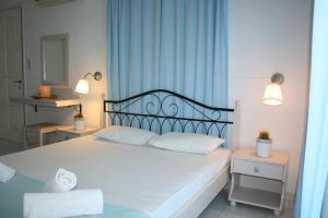 A bed or beds in a room at Agnanti Hotel