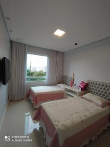 A bed or beds in a room at Lindo Apartamento no Campo Grande