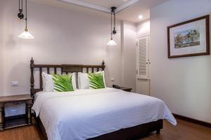 A bed or beds in a room at At 21 Saladaeng