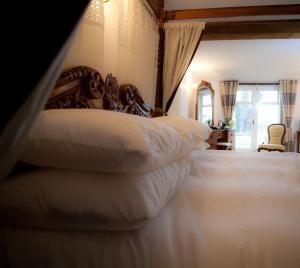 A bed or beds in a room at Shave Cross Rooms