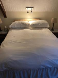 A bed or beds in a room at The Old School House Hotel