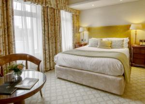 A bed or beds in a room at Thurlestone Hotel