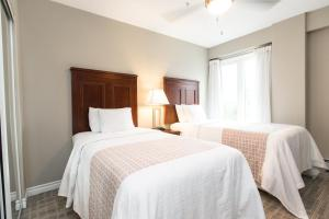 A bed or beds in a room at Canterra Suites Hotel