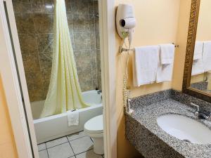 A bathroom at Budget Inn Jonesboro